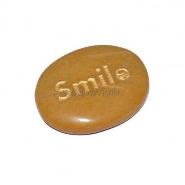 Yellow Jasper Smile Engraved Stone