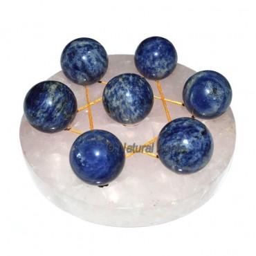 Seven Ball of Sodalite with Rose Quartz Base David