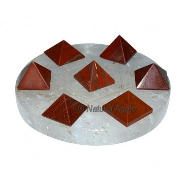 7 red jasper pyramids with crystal Base