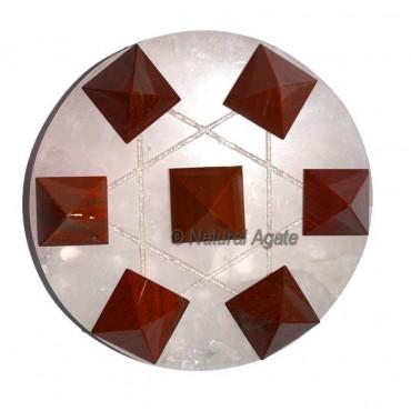 7 red jasper pyramids with Rose Quartz Base