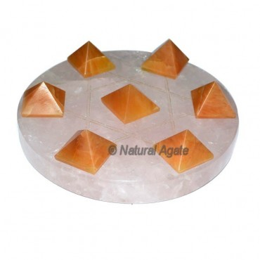7 Golden Quartz Pyramids with Rose Quartz David St