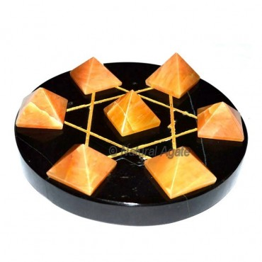 7 Golden Quartz Pyramids with Black Agate Base