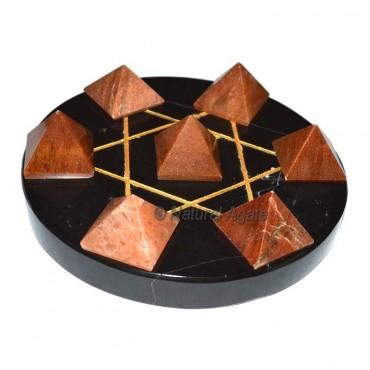 Seven Peach Aventurine Pyramids with Black Agate D