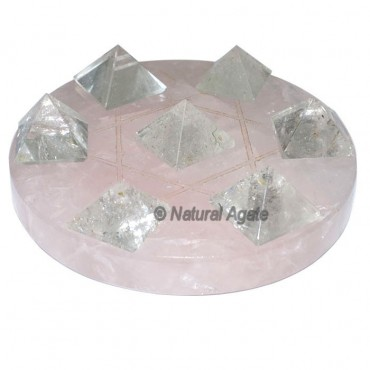 7 crystal Pyramids with Rose Quartz David Star Bas