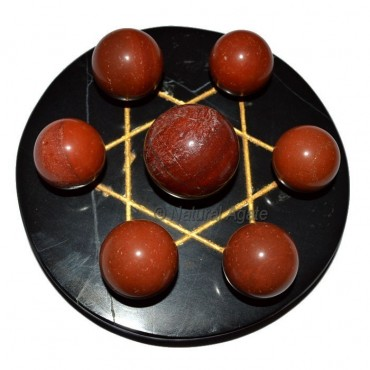 7 Red Jasper Ball with Black Gold David Star Base