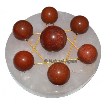 7 Red Jasper Ball with Rose Gold David Star Base