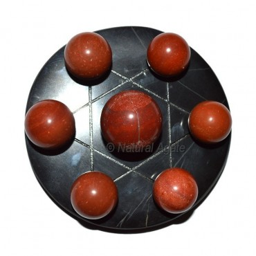 7 Red Jasper Ball with Black David Star Base